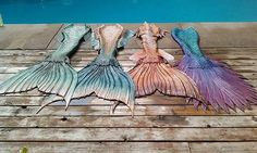 Full silicone mermaid tails made by Finfolk Productions.