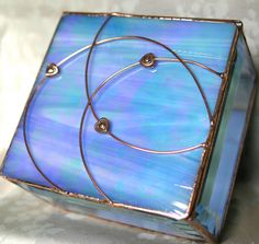 Contemporary stained glass jewelry box with a beautiful blue iridescent glass lid embellished with a triplet of copper