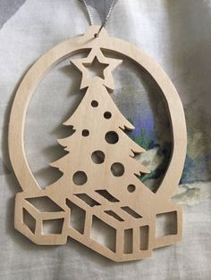Scrollsawn wooden Christmas tree with gifts underneath tree Ornament by…