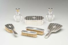 Cartier dressing table set with silver, enamel and glass circa 1915. Image: Courtesy Hillwood Estate, Museum and Gardens.