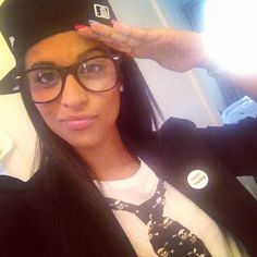 Lily Singh (Superwoman on youtube) wearing a flat brimmed cap.