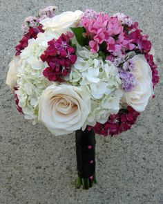 The Bridesmaids wore watermelon dresses so these bouquets were designed to stand out against the bright color. White hydrangea, roses and sweet William are the perfect mix!