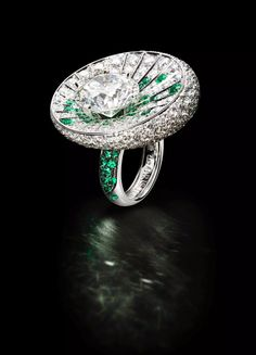 Founded by black diamond pioneer Fawaz Gruosi, Geneva-based de Grisogono is showing this high jewelry white gold ring featuring a 10.15 ct. round diamond accented with 1.2 cts. emeralds and 8.97 cts. t.w. white diamonds