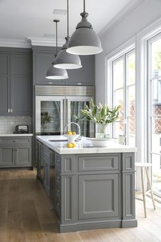 Grey kitchen cabinets are one of the classic colors. If you want to create classic kitchen design these 20 ideas are for you. Updated for When choosing grey kitchen cabinets, you have several aspects to think about. What wall… Continue Reading → Farmhouse Kitchen Cabinets, Kitchen Cabinet Design, Rustic Kitchen, Classic Kitchen Cabinets, Soapstone Kitchen, Wooden Kitchen, Kitchen Ideas With Grey Cabinets, Kitchen Countertops, Grey Painted Kitchen Cabinets