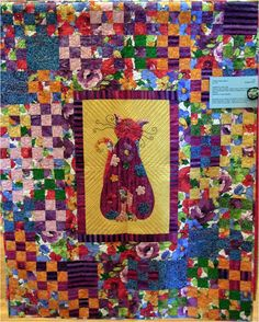 Flower Queen Kitty, 47 x 59, exhibited by Mary Fish.  2012 RCQG.  Photo by Quilt Inspiration