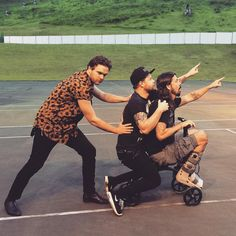 Mike Kerr, Ben Thatcher, Dave Grohl, and a tricycle   Foo Fighters and Royal Blood tour Summer 2015