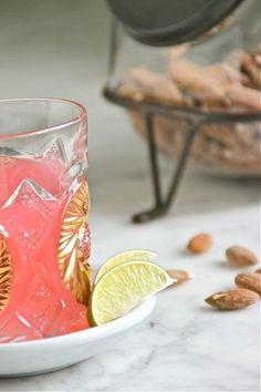 Gin & Rhubarb Cocktail   • 1 ounce rhubarb syrup • 1/2 ounce lime juice • 1 1/2 ounces gin • 1 ounce seltzer -- plus additional seltzer, optional • lime slices, for garnish