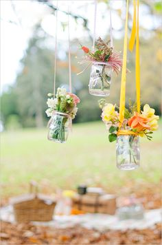 Hang flowers in mason jars with ribbon from trees - adorable!