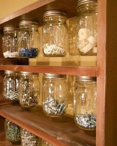 Use small mason jars for organizing the small stuff... see more garage organization tips in this post!