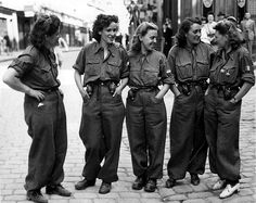 FRANCE-- These women are members of the FFI (French Forces of the Interior), acting as guides, scouts, and assisting in mopping up the Germans in captured towns. August 16, 1944