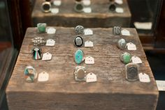 rings on wood blocks with simple tags