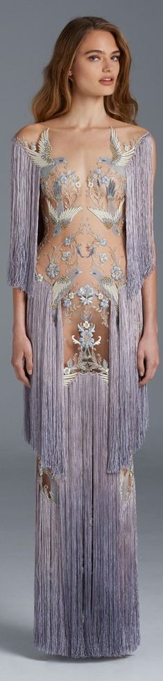 Paolo Sebastian 2015/16. Definitely not sure about this, it seems very 'Rhianna' and her revealing dress but I do like the fringing and the colour. The Bird embellishments are gorgeous I just feel it would have been more classy to have put a nude body underneath it or applied more embellishments, but that's just me. I favour the designers that are a little more sophisticated and chic. My teenage daughter hates it! :/