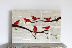 cardinals on branches from fiddleheadsforfiona on etsy. Would be cool to create similar with sheet music and song birds.