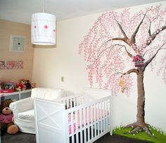 Wall painting of a blossom tree in nursery.