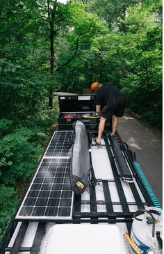 Aluminess roof rack on a Mercedes Sprinter van...customized for solar panels and A/C opening, and lots of tie down area for toys!