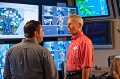 Phil Holmes, right, vice president of the Magic Kingdom, at the park's underground control room. Disney uses the command center to monitor rides around the park and control crowd size.