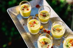 passed appetizer inspiration - summer melon gazpacho garnished with chrysanthemum grown locally on our urban farm Sour Plum, Lunch Delivery, Greens Restaurant, Green Farm, Daily Specials, Hors D'oeuvres, Breakfast Burritos, Gazpacho, Menu Items