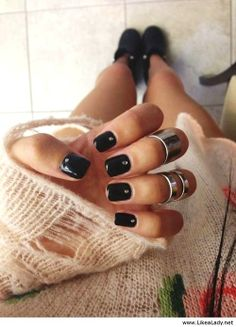 Black nails….of course…with crystal accents. #black #nails #manicures