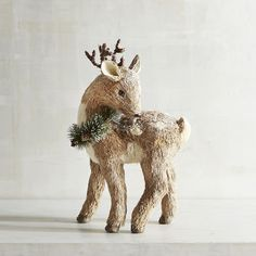 Invite our shy little deer over for the holidays. Handcrafted of sisal and…