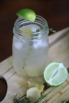 Gin with ginger ale and lots of lime juice!