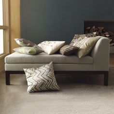 Want the living room to have a low chaise the coordinates with a long sofa and a love seat....