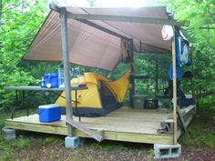 Great idea for camping on your remote property. High and dry. Set it 3-4 blocks higher and have lots of storage space 'below deck'. Make the platform longer and put up a dining canopy (mosquito netting). Quite inexpensive, 1 day to build & that elevated, pressure treated wood will last for years(!). (This was the photographer's home for 3 1/2 months while white-water rafting in West Virginia.)