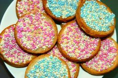 Whenever someone has a baby in the Netherlands, they give out a rusk (beschuit) with muisjes (candy-coated aniseed) = Pink for a girl (meisje) and baby blue for a boy (jongen).  If the Dutch Royal family has a baby, De Ruijter-brand has a special orange version that they sell to the public, so that the people can also celebrate.  http://en.wikipedia.org/wiki/Muisjes