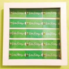 Can't stand the thought of throwing away your Lilly tags? Make a colorful display by putting them in a shadowbox!