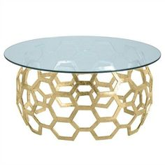 Windsor Smith for Arteriors Home says the mantra in creating the modern, elegant Dolma Cocktail Table, a basket inspired weave, was a marriage of global craft and modern geometry. Cast aluminum hexagons are combined into a circular form and then plated with brass and polished to a high sheen. Think of this as jewelry for the living room or another sitting area in the home!  *Shown with a  round glass top.