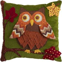 Quite the head-turner, isn't it? Our colorful owl pillow is a one-of-a-kind fabric-art collage of pattern, texture and applique. Fun to behold and more fun to hold, it's a comforting design for fall and all year long.