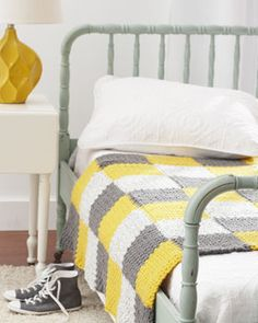 With funky color-blocking and modern colors, this crocheted afghan will bring a room to life. Shown in Bernat Softee Chunky.