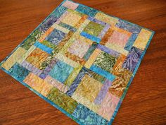 Colorful Quilted Batik Table Topper, Square Table Topper Runner, Coffee Table Runner, Quilted Tablecloth, Purple Gold Blue Green, Table Mat by SusiQuilts on Etsy