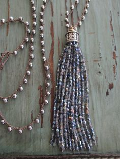 "Sparkly tassel necklace - Shimmering Sea by slashKnots- A crocheted chain of sparkly faceted semi-precious stones with an equally sparkly long glass tassel with iridescent blue undertones. 34""L with a 4 1/2"" tassel drop."