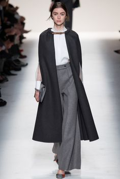 Valentino Fall 2014 RTW Collection, these high-waisted, flare trousers in gray. Image via Style.com