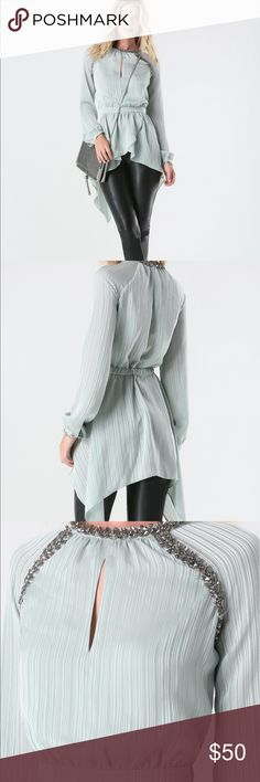 Bebe embellished tunic Size xxs. Tags attached. Paid $119. Embellished around neckline. Aqua blue color bebe Tops Tunics