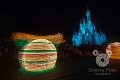 Spinning Turtle in the Main Street Electrical Parade infront of Cinderella Castle in the Magic Kingdom at Walt Disney World Resort