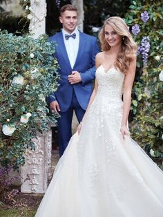 Rebecca Ingram - edith, This gorgeous A-line wedding dress features a bodice of shimmering lace motifs, with a voluminous tulle skirt accented in vintage-inspired beading. Complete with strapless sweetheart neckline. Finished with covered buttons over zipper and inner elastic closure.