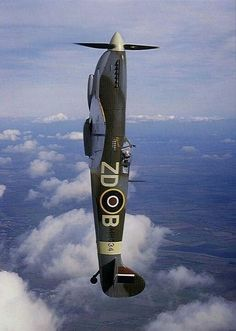 Vertical British Supermarine Spitfire WWII RAF Pursuit Fighter Aircraft. One of the best and most formidable Planes of War in History.