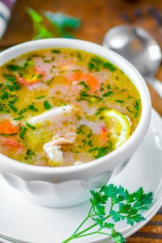 Lemon Chicken Rice Soup, a healthy made from scratch chicken and rice soup with lots of fresh herbs, lemon and carrot noodles. Friends, this gluten free soup will fly from kitchen to dinner table b...