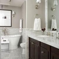 Bathroom with marble tiled floor, marble half wall, basketweave marble tiled floors, basketweave accent tile, tiled rug, espresso...