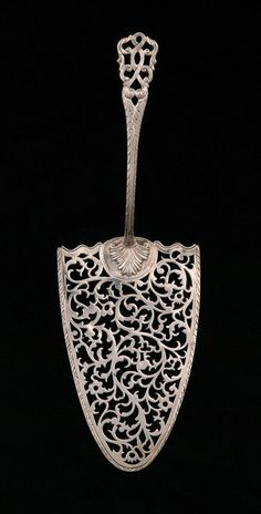 """1768 British Fish slice at the Museums Sheffield, Sheffield - From the curators' comments: """"This is a silver fish slice made in London in the late eighteenth century. It was intended for use in separating and serving portions of fish. Earlier designs were Vintage Love, Vintage Silver, Antique Silver, Sterling Silver Flatware, Silver Spoons, Vintage Cutlery, Decoration Table, Metal, Antiques"""