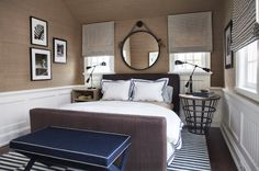 East Coast House with Blue and White Coastal Interiors: This bedroom is the perfect combination of coastal and masculine decor. It features a dark taupe upholstered bed layered with navy hotel bedding. Home Bedroom, Bedroom Decor, Bedroom Ideas, Bedroom Seating, Nautical Bedroom, Bedroom Inspo, Master Bedroom, Coastal Bedrooms, Navy Bedrooms