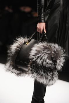 J Mendel - This bag is quite suited to formal wear because of the black colour and leather, but the fur adds a lot of fun to it. The different textures of the smooth leather and fluffy fur make the bag more interesting. Fur Fashion, Fashion Bags, Fashion Trends, Fashion Handbags, My Bags, Purses And Bags, Sacs Design, Fur Bag, Fur Purse