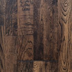 """Vintage Timber, from our Reclamation Plank Collection by Heritage Woodcraft is a hand-scraped (7-7/8"""") wide-plank solid oak hardwood flooring. It's solid construction and wide plank width is achieved by finger-joining three sections of solid oak hardwood together prior to the hand-sculpting of the plank. Once distressed, these three planks become one visually stunning plank. Entirely hand-scraped using three techniques: soft sculpting, edge distressing and chisel carving. Each plank unfolds…"""