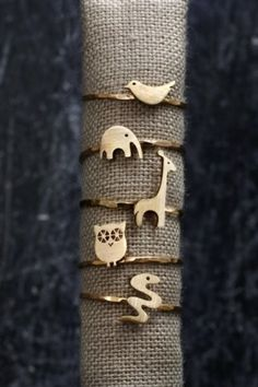 AF house's tiny animal rings- owl, giraffe, elephant, birdie, snake!  wish they came in sterling silver instead of gold. ... pinned with Pinvolve - pinvolve.co