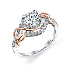 Flourishes of 18K rose gold gracefully adorn a brilliant center diamond in this updated look from the Lyria Collection. Diamond Info: 28-RD 0.25 CTS Fits center stone size RD: 6.0-6.5 MMGUIDE Center stone not included.