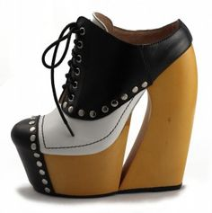 """Ego And Greed """"Downtown""""  Super awesome spin on a spectator shoe. The platform and heel define this design."""