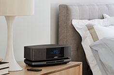 Indulge in the Wave SoundTouch music system from Bose. The Wave SoundTouch system easily connects to your home Wi-Fi, expands easily and comes with a handy remote. Small Entertainment Center, Multi Room Speakers, Bose Lifestyle, Digital Signal Processing, Clock Display, Music System, Radio Alarm Clock, The New Wave, Bluetooth Speakers