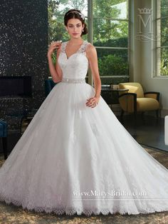 Tulle and lace bridal ball gown with sweetheart neckline, lace shoulder straps, illusion lace back, beaded waistline, chapel train, and back zipper with buttons.