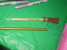 "Merida Brave Party: ""The Crafty Carver"" Witch's Broomstick pens and Personalized ""Arrow"" pencils in the goody bags! Both pens and pencils I ordered from Oriental Trading online. I cut green foam sheets into the arrow feathers and hot glued them in place"